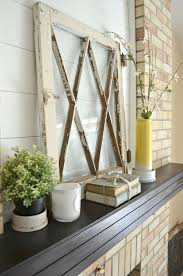 sarah from little vintage nest uses these pretty old windows as decor just leaning on her mantel no nailing no glueing no work at all