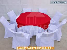white chair covers with round table cloth with white table cloth and red overlay runner