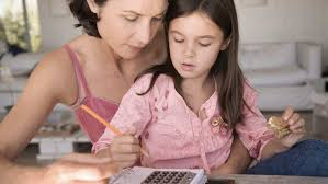 common myths about dyscalculia and math learning disabilities mom helping daughter math homework using a calculator