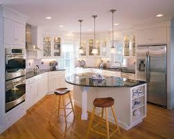 round kitchen islands Kitchen Traditional with accent lighting beadboard  beadboard. Image by: Polhemus Savery DaSilva