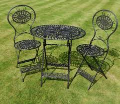 black iron outdoor furniture. Rod Iron Patio Furniture With Material Over Green Grass Black Outdoor