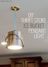 Thrift store ice bucket turned pendant light via MakelyHome.com