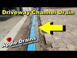 channel drain in paver driveway sump