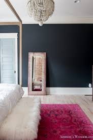 master bedroom black walls white wood bead chandelier whitewashed hardwood flooring four poster bed restpration hardware inkwell rug 5 of 19