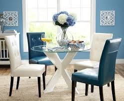 a contemporary take on the traditional parsons chair blends well with a bold modern table apartment furnituredining room