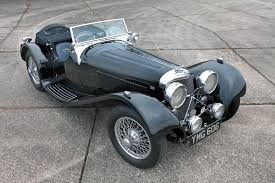 considered by many to be the world s first sports car the jaguar ss100 made its debut at the london motor show in 1936 initially with a 2 5 liter power