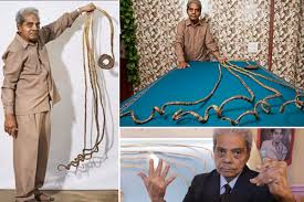 indian man with guinness world record of longest nails cuts them after 66 years