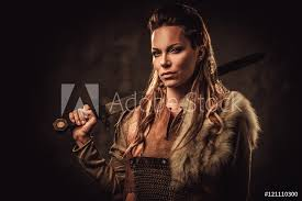 Fotografie Obraz Viking Woman With Sword In A Traditional Warrior