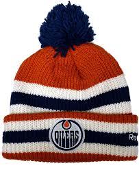 Edmonton oilers nhl floppy hat. Edmonton Oilers 2016 Nhl Heritage Classic Cuffed Pom Knit Hat Size One Size Lubricants Amazon Canada