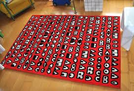 walter van beirendonck for ikea red design rug with strange eyes