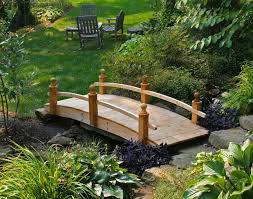 ... Wooden Bridge Set Over Small Water In Your Greenery Garden ...