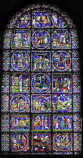 the window has a simple round arched top the stained glass is supported by