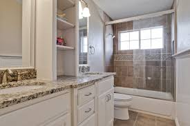 small ideas master guest intended  bathroom white wooden storage with cream black marble counter top als