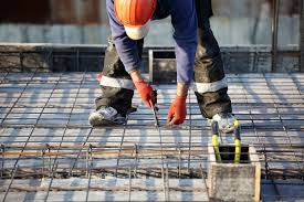 construction worker placing rebar on project site rebar worker