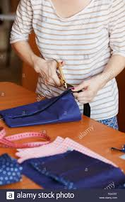 Fashion Designer Part Time Job Young Woman Sewing At Home Hemming Blue Fabric Fashion