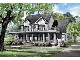 luxury plantation style two sory with a second floor balcony and first floor covered porch