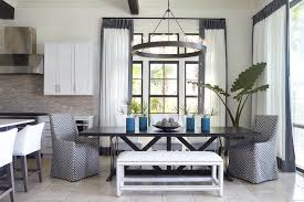 black trestle dining table transitional room tracery chandeliers ralph lauren chandelier