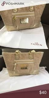 COACH Poppy Op Art fabric handbag. COACH off-white and gold Poppy Op Art  fabric handbag. This is a great bag is excellent condition.