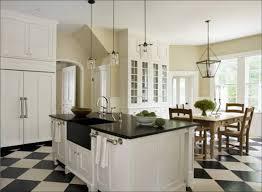 white kitchen black and white floor dark countertops
