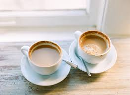 two coffee cups with coffee. Modren Coffee White Coffee Cups And Saucers Throughout Two With I