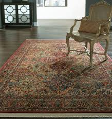 amazing karastan rugs and wood flooring with accent chair for home interior design
