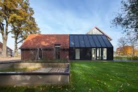 farmhouse renovation by bureau fraai barn half and half
