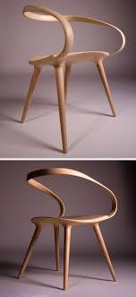 This flowing, curved wooden armchair was designed by Jan Waterston, after  he was inspired