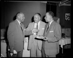 FROGS members Harry G. Washington, Charles Rickmond, and Byron Peters,  standing in the Villa Monaco for 47th Annual FROGS Week   CMOA Collection