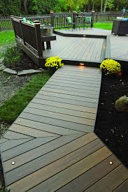 Tigerwood decking by TimberTech was used for this gorgeous platform deck  and walkway. In addition, there are unique design accents: perimeter board  ...
