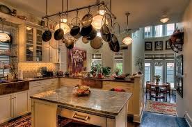 at the back of the house the kitchen with holophane style lights and art deco kitchen lighting
