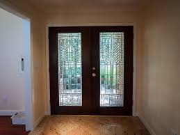 double black wooden doors with glass on the middle