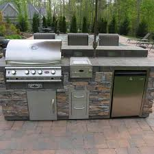 overlooking the backyard s pool area this custom outdoor kitchen was designed to keep people outside