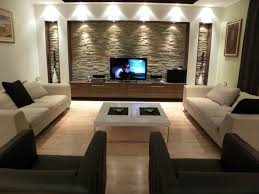 trendy living room with stone wall
