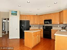 limestone tiles kitchen: traditional kitchen with hardwood floors specialty door raised panel kitchen island u