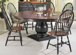 round pedestal dining table finished in black paint