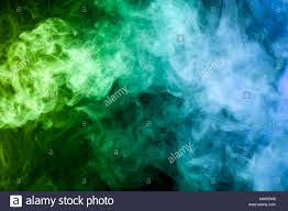background green and blue colorful yellow blue and green smoke on a black isolated