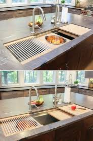 minimalist kitchen sinks with movable cutting board and retractable faucets wooden cutting board grey worktop wooden
