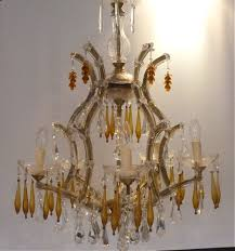 this is a beautiful 5 arm marie therese chandelier made up from a mixture of clear lead kite droplets and amber twirls to create a truly unique and one off