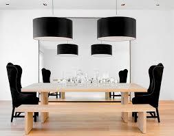 view in gallery black drum pendants bring grandeur to the dining room