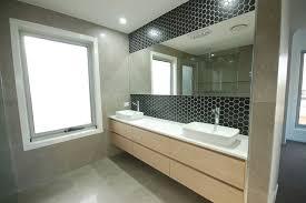 matt black hexagon feature wall modern bathroom