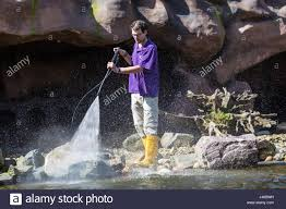 zookeeper cleaning. Exellent Zookeeper A Male Zookeeper Is Cleaning With A High Pressure Spray  Stock Image And Zookeeper Cleaning P