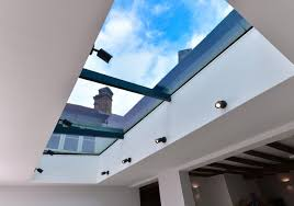 pure glass roof light bifolding doors