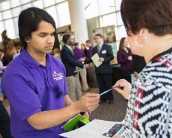students and employers benefit from career networking day senior magus pereira networks vidant health s tammy wilkins during the 2017 annual career networking day