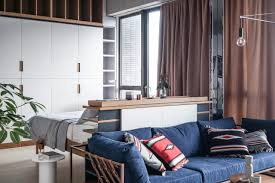 studio living room furniture. Over-sized Headboard Separating Bed From Stephen Kenn Sofa In A Spacious, Open- Studio Living Room Furniture T