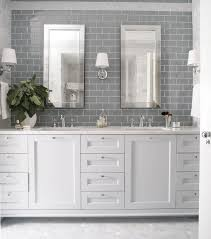 white bathroom cabinets. i love subway tiles but this needs a pop of colour to really shine . wall tile behind vanity // heather garrett design - bathrooms gray tile, white bathroom cabinets