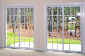 sliding glass door. Two Sets Of Sliding Glass Doors With Woods Outside - Comfort Windows Door