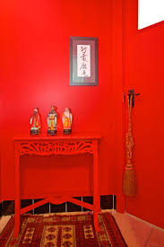 red hallway table. susan\u0027s bedroom is filled with light from the private courtyard it opens onto. yellow painted walls are softened more of her gardening handy work. red hallway table w