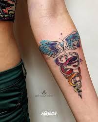 фото татуировки кадуцея в стиле авторский акварель графика лайнворк