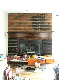 how to stain a brick fireplace black paint was perfect for this old outdated fireplace makeover