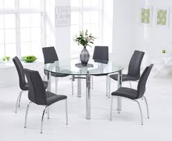 melbourne 145cm round glass extending dining table with cavello chairs